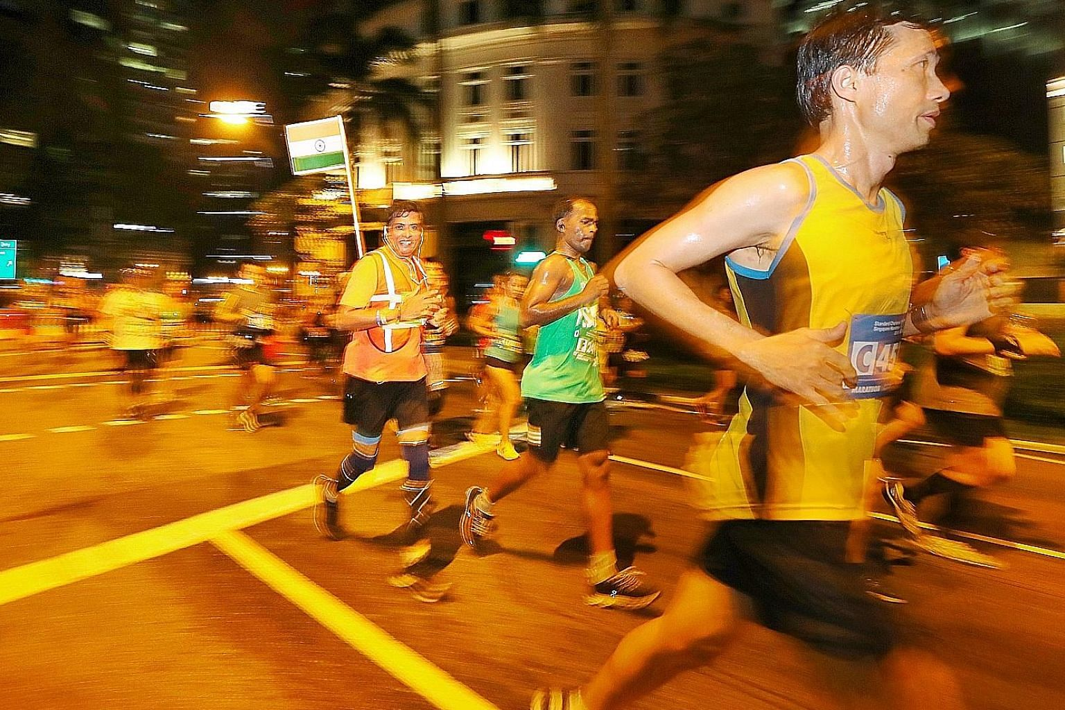 Some 30,000 participants pounded the roads in the downtown area, including Robinson Road.