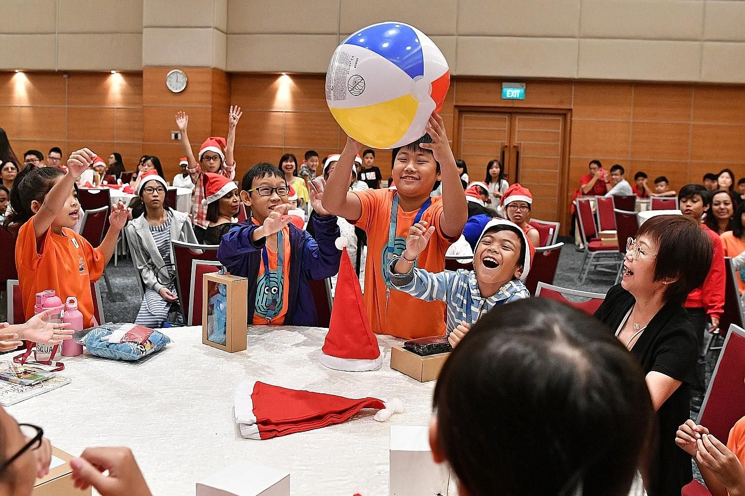 Reuben Tan, 10, from Care Community Services Society enjoying a game at a lunch party yesterday hosted by Singapore Press Holdings (SPH). He was among 160 beneficiaries from charitable organisations and their caregivers who were treated to games and