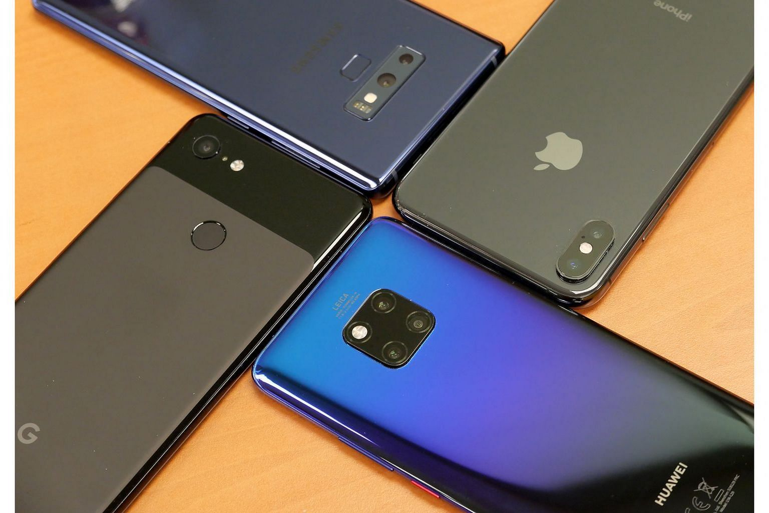 Smartphone Camera Shoot-out: (From top right clockwise) Samsung Galaxy Note9, Apple iPhone XS Max, Huawei Mate 20 Pro and Google Pixel 3 XL. ST PHOTO: TREVOR TAN