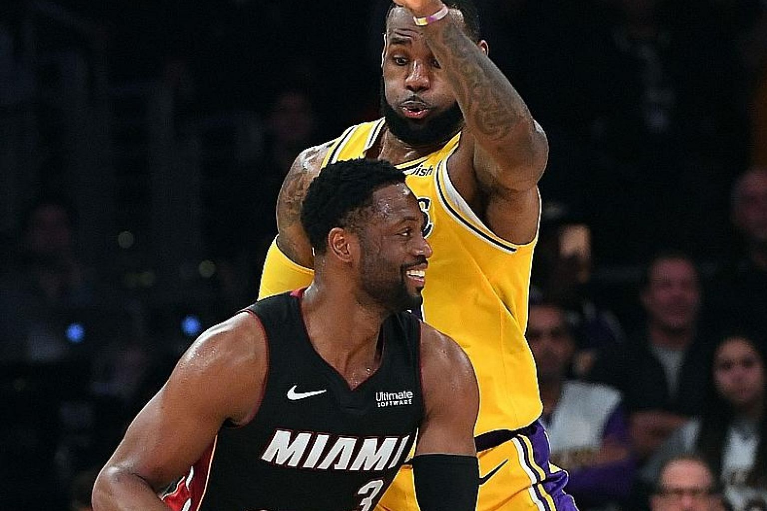 Dwyane Wade (front) and LeBron James arrived in the NBA as part of a star-studded draft in 2003. Monday's contest was the 31st between the two players, with James' Los Angeles Lakers hanging on to beat Wade's Miami Heat 108-105.