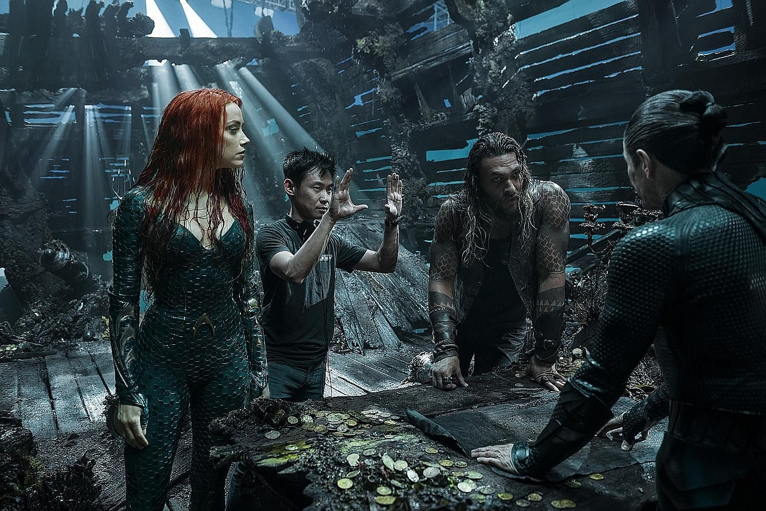 Aquaman director James Wan (second from left) on set with stars Amber Heard and Jason Momoa.