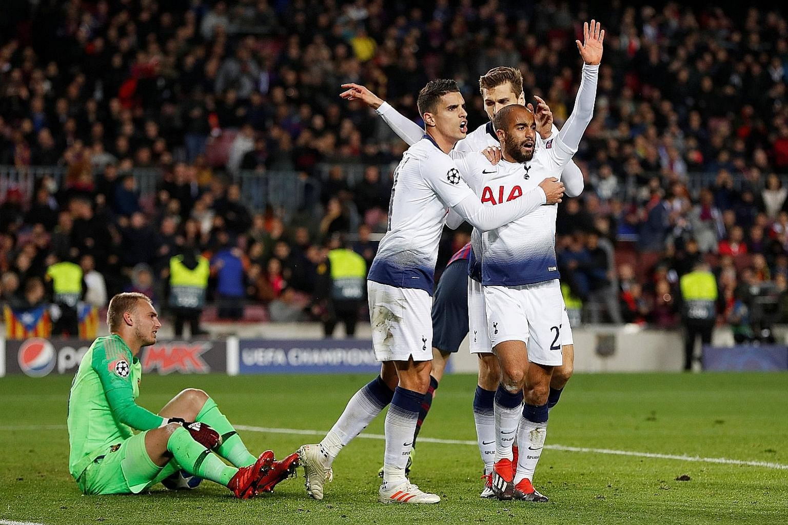 Tottenham's Lucas Moura (front) celebrates with teammates Erik Lamela and Fernando Llorente after scoring the vital equaliser against Barcelona at the Nou Camp on Tuesday. The 1-1 result ensured that Spurs are through to the last 16 of the Champions