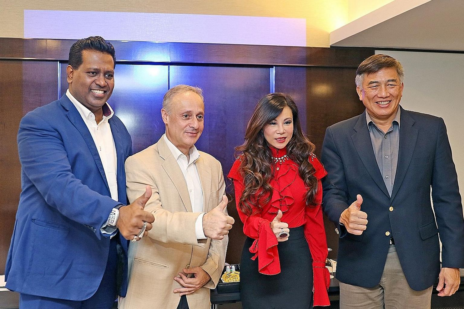 From left: Sheik Alau'ddin, the world championship's organising chairman; Mohit Lalvani, CEO of 1 Play Sports; entrepreneur Grace Kong; and Lim Teck Yin, CEO of Sport Singapore, giving the event the thumbs up.