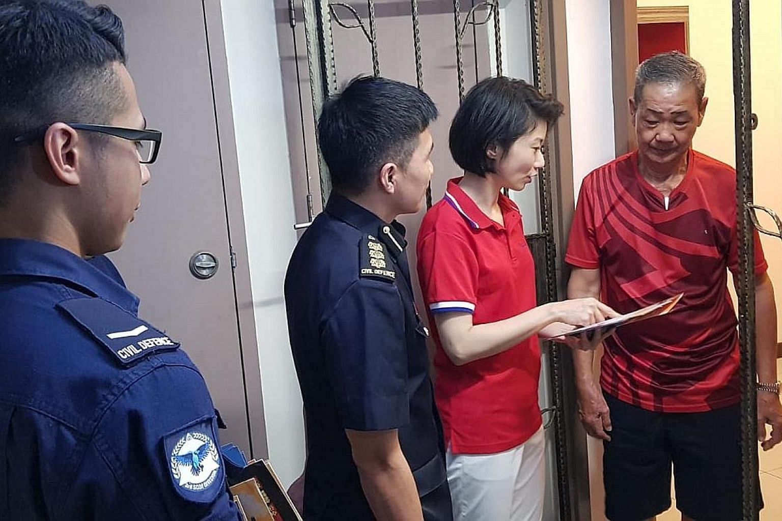 Ms Sun Xueling, an MP for Pasir Ris-Punggol GRC, engaging a resident on fire safety last night. It was the need for such public education efforts that prompted Ms Sun