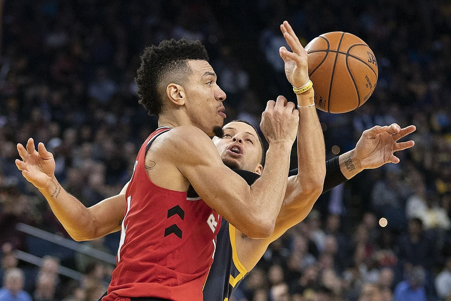 Toronto's Danny Green outmuscling Golden State's Stephen Curry for the ball during the Raptors' 113-93 win at the Oracle Arena. It was their first win in 14 years at the Warriors' home.