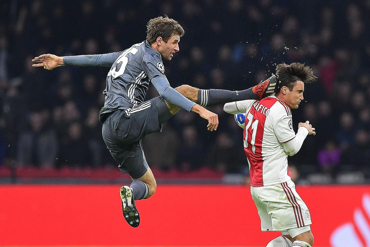 Bayern Munich's Thomas Muller saw red after missing the ball and landing a head-high kick on Ajax left-back Nicolas Tagliafico in their Champions League game.