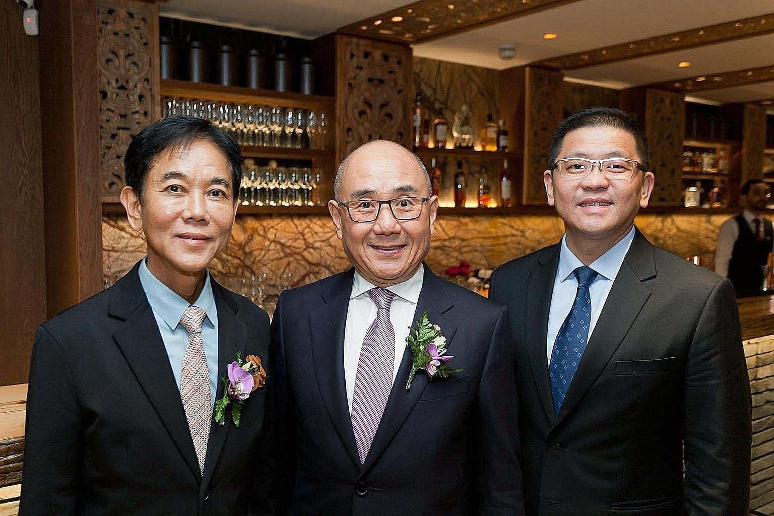 (From far left) BreadTalk founder and chairman George Quek, Din Tai Fung chairman Yang Chi-hwa and BreadTalk Group CEO Henry Chu at the opening of Din Tai Fung's first London branch on Dec 5. The group will open a second London branch in the middle o
