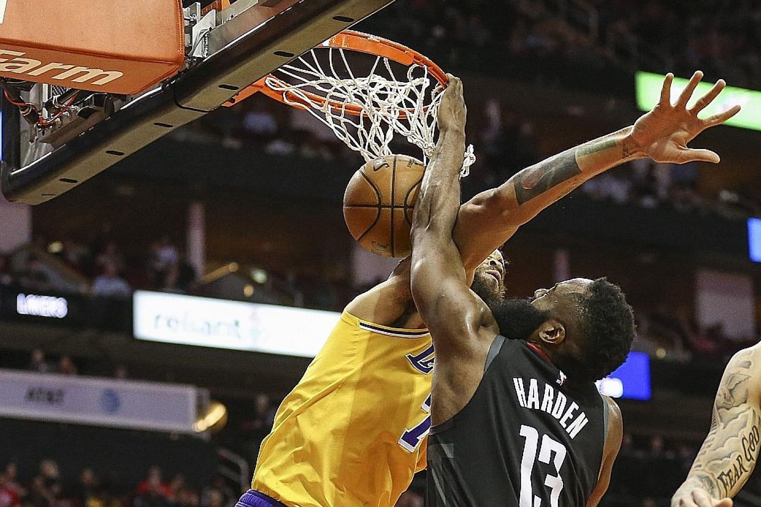 Rockets guard James Harden dunking over Lakers centre JaVale McGee in the first quarter of the game at the Toyota Centre in Houston, Texas. His reaction - he flexed both arms and snarled - had everyone taking notice. Houston won 126-111 but are still