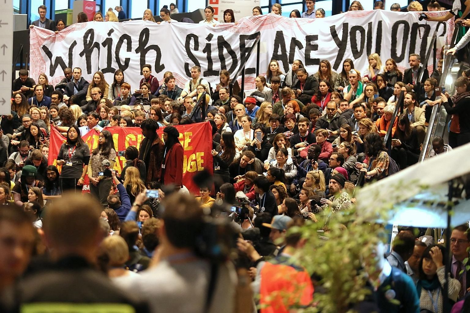 A rally by environmental groups being held alongside the UN climate talks in Katowice, Poland, on Friday. Delegates at the two-week talks were tasked with completing a complex rule book that would allow the 2015 Paris climate agreement to go into act