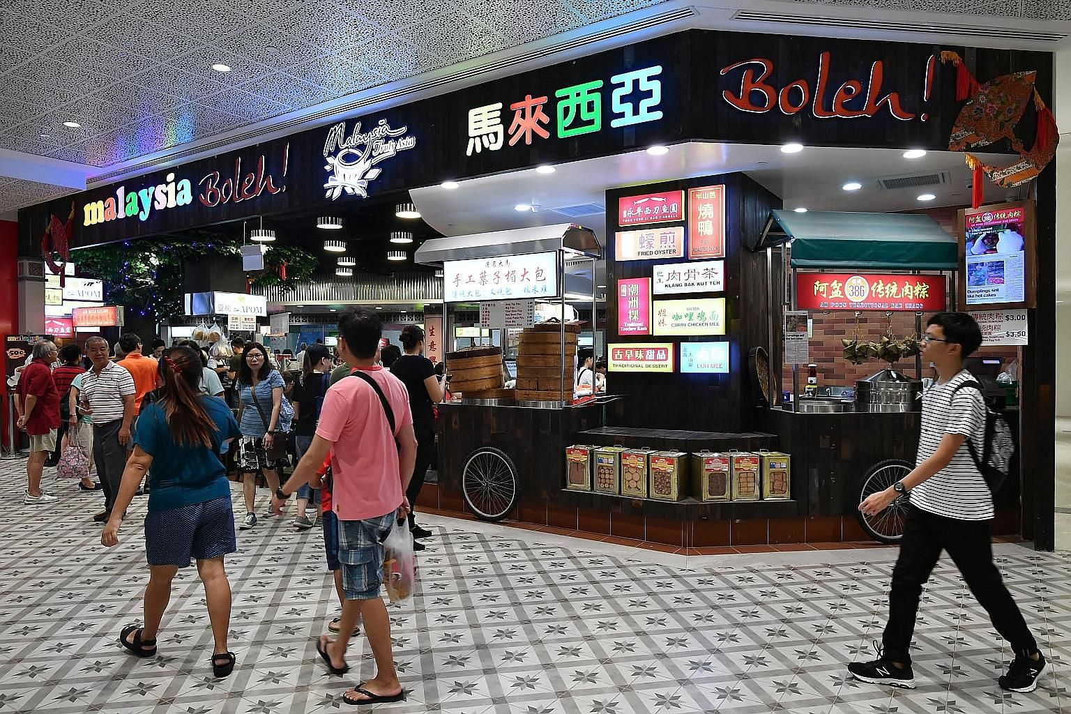 Malaysia Boleh! at AMK Hub, which opened last month, houses 25 stalls. Chendol at the Penang Hawkers' Fare buffet in York Hotel, which has returned for the third time this year.