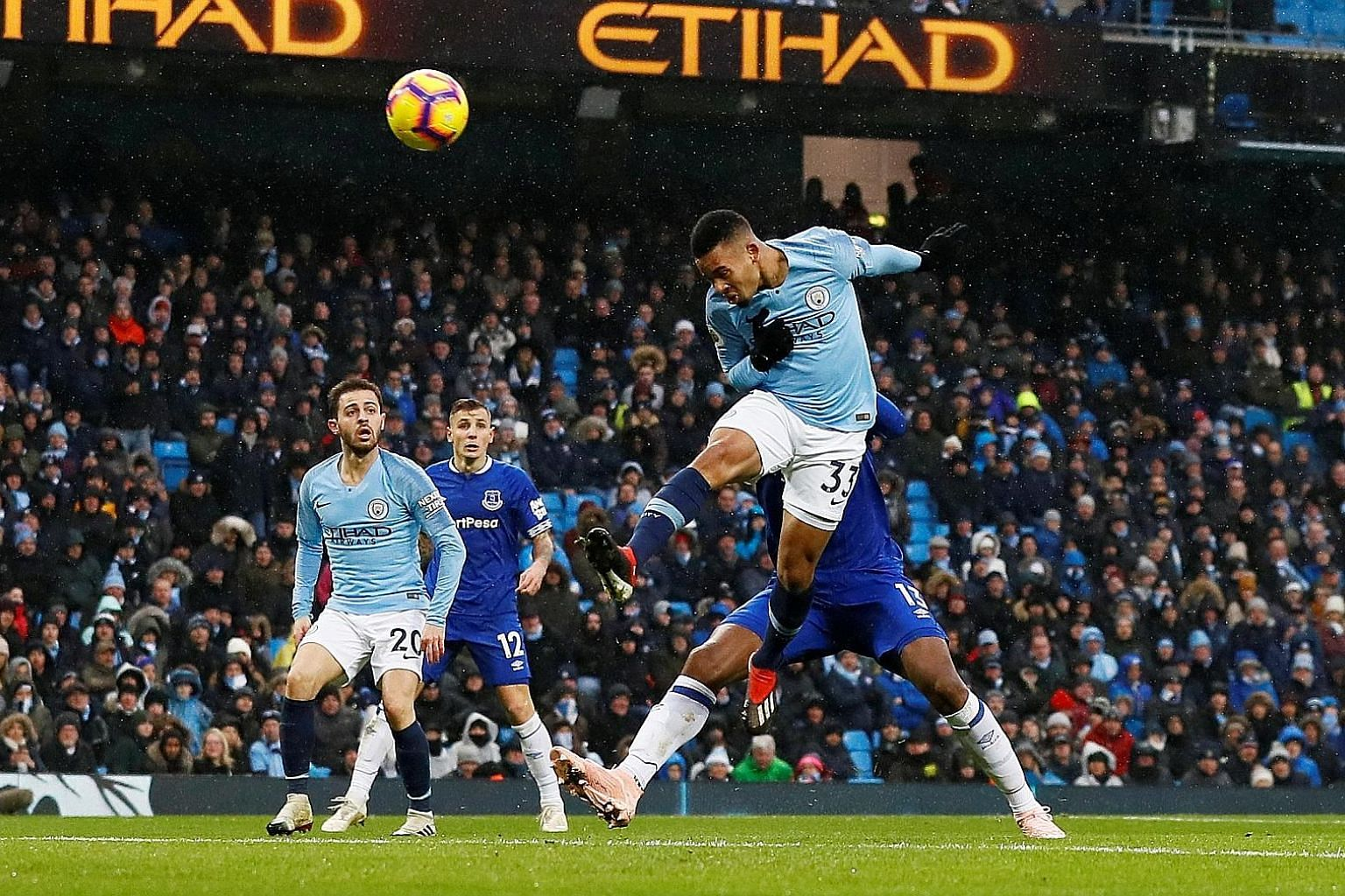 Manchester City's Gabriel Jesus powering a header past goalkeeper Jordan Pickford (not pictured) to make it 2-0 against Everton in the Premier League yesterday. The match ended 3-1 in favour of City, who also scored through Raheem Sterling.