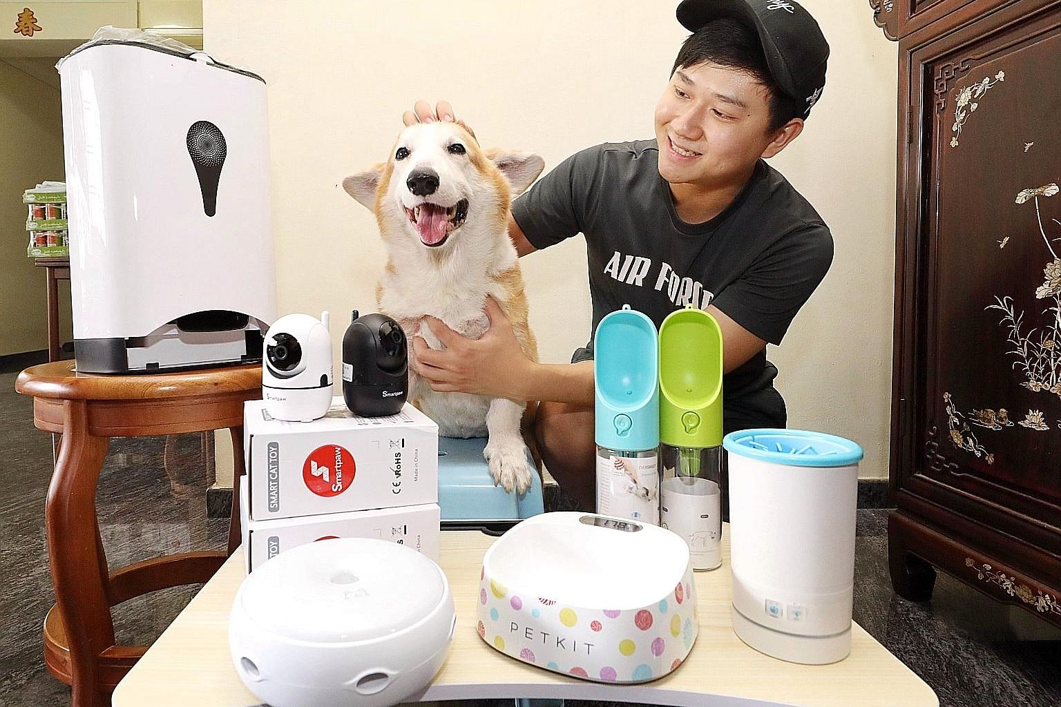 Mr Dean Tan with his eight-year-old corgi named Cube. He started the Smartpaw website in 2016 to sell dehydrated dog treats and later switched to selling electronic pet products like feeders, cameras and paw washers.
