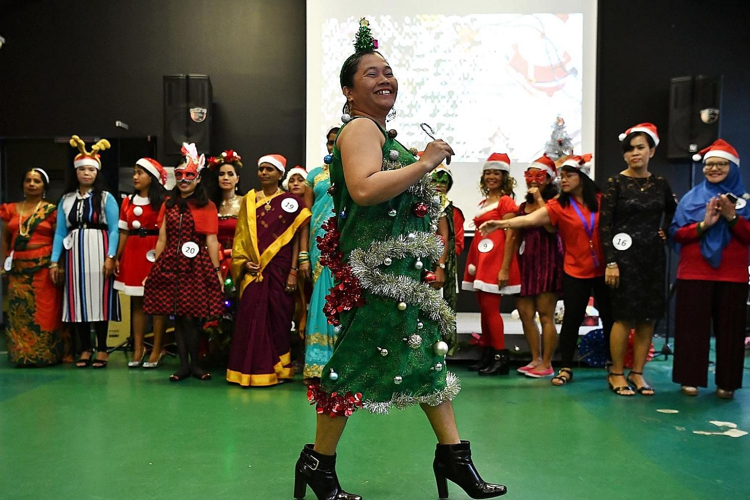Filipino domestic worker Jane Hortillas Gabinete, 43, dressed up as a Christmas tree for a best-dressed competition during the festive celebration organised by the Foreign Domestic Worker Association for Social Support and Training yesterday at its c