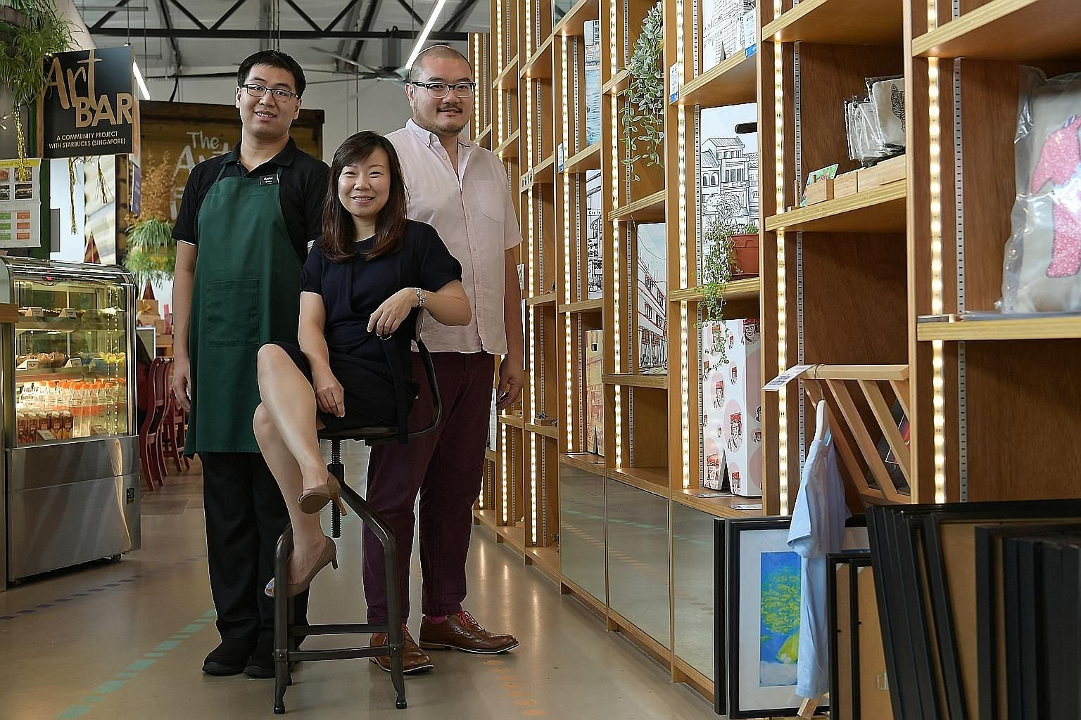Ms Jacelyn Lim, ARC's deputy executive director, flanked by Mr Caleb Lim (in apron) and Mr Victor Ong, the centre's creative director, at the Art Faculty's flagship store in Lengkok Bahru.