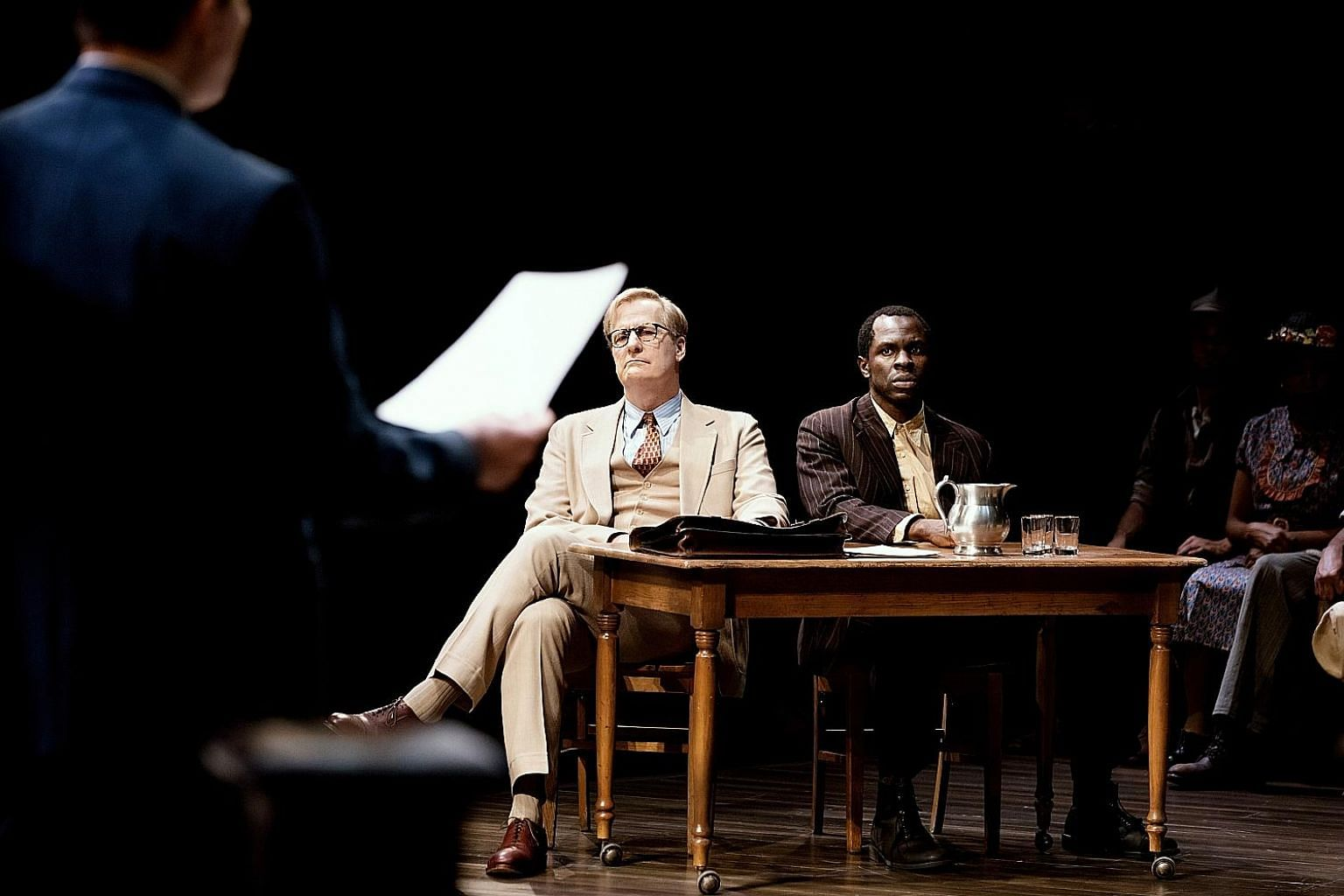 Jeff Daniels (right) plays lawyer Atticus Finch, while Gbenga Akinnagbe (far right) plays Tom Robinson, a labourer wrongly accused of rape, in the Broadway production of To Kill A Mockingbird.