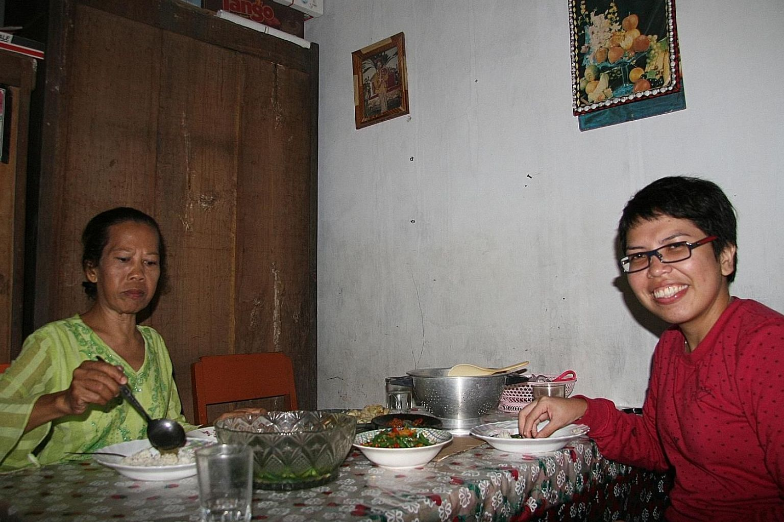 The writer having lunch with her grandaunt Titi Setyawati (above) at the family home in Indonesia's Purbalingga regency in May 2009. During her trip, the writer also interviewed Sumanto (below), a cannibal in the neighbouring village who was jailed f