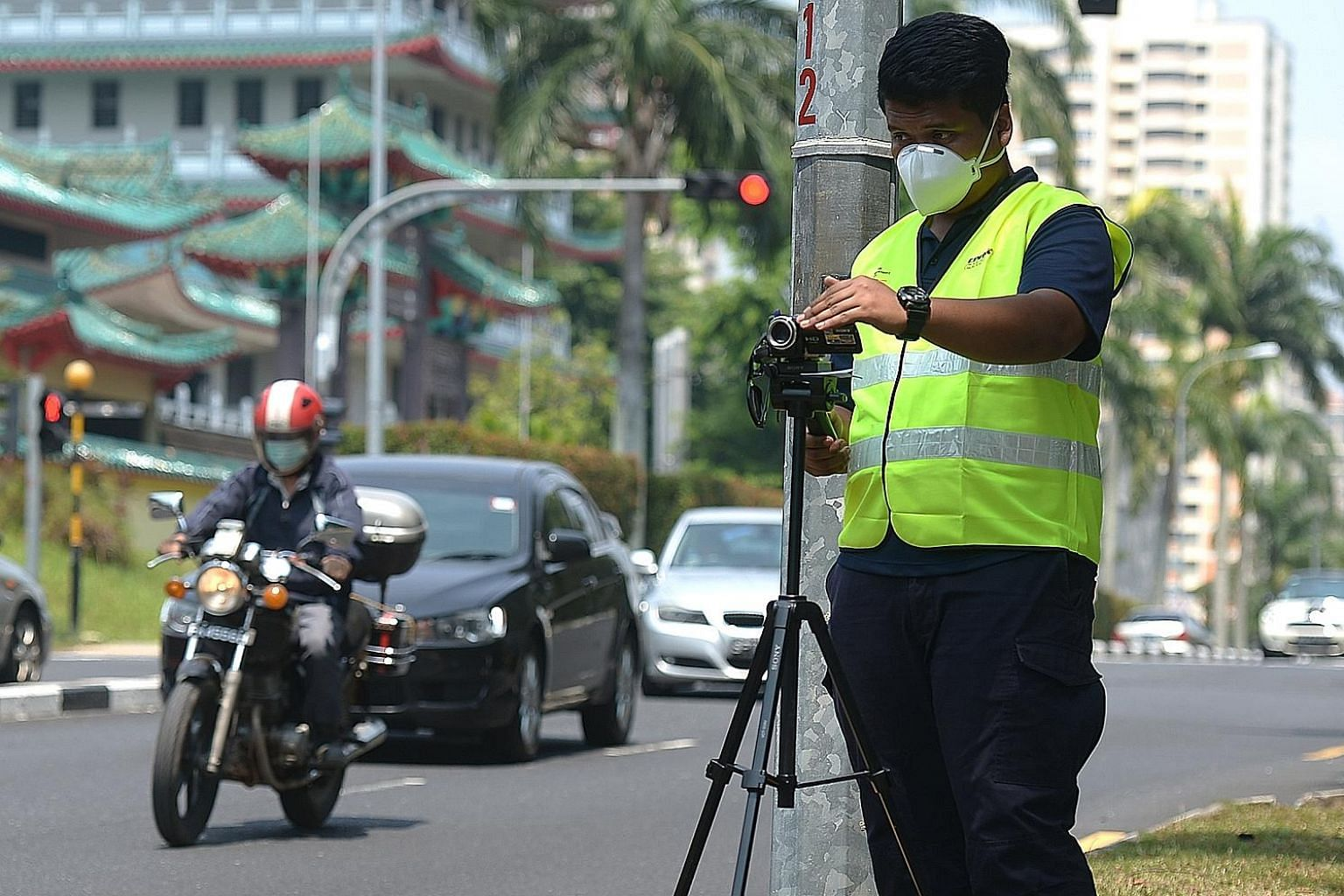 An enforcement officer looking out for smoky vehicles on the road. Starting next month, the National Environment Agency will accept results from the Worldwide Harmonised Light Vehicles Test Procedure, which measures both the fuel consumption and poll