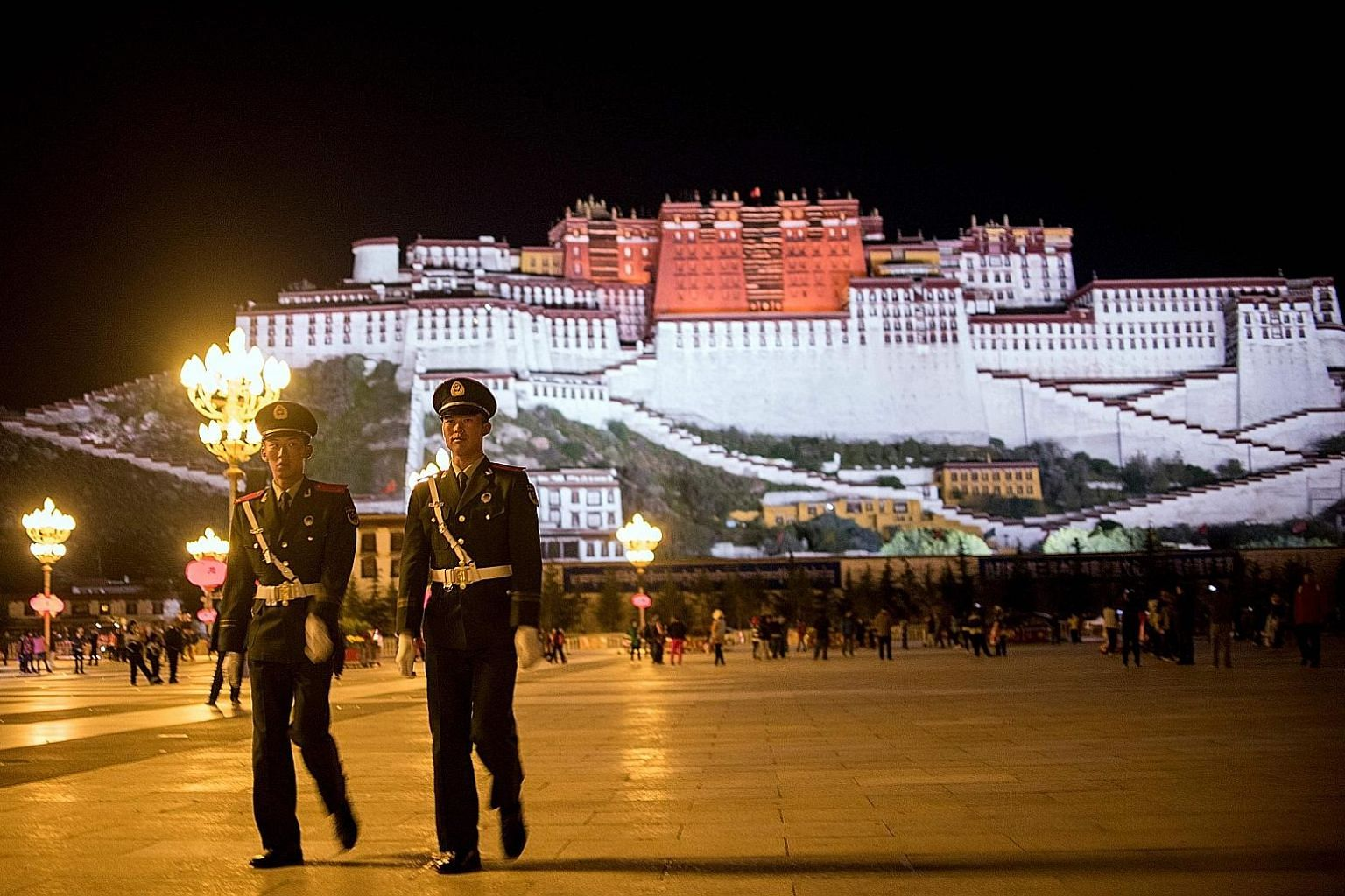 """Chinese paramilitary policemen patrolling near Tibet's iconic Potala Palace in Lhasa in 2016. The US' Reciprocal Access to Tibet Act """"denies Chinese government officials access to the US if they are responsible for creating or implementing restrictio"""
