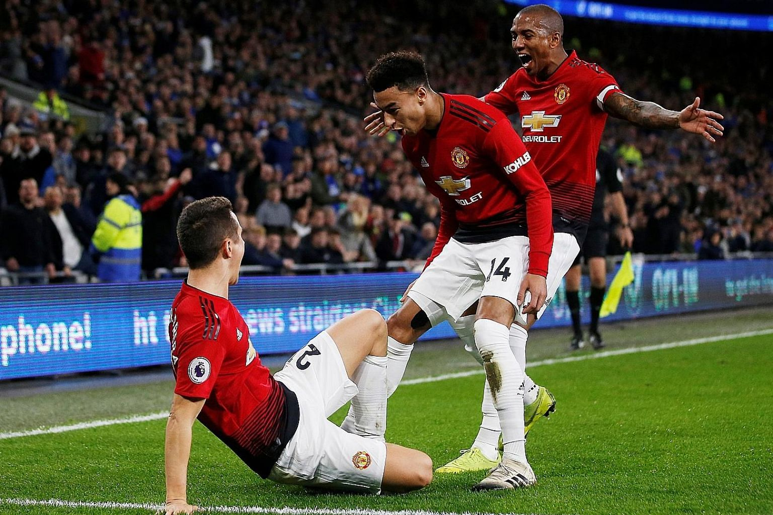 Ander Herrera celebrating with Jesse Lingard and Ashley Young after putting United 2-0 up against Cardiff on Saturday. The 5-1 win closed the gap on fourth-placed Chelsea to eight points.