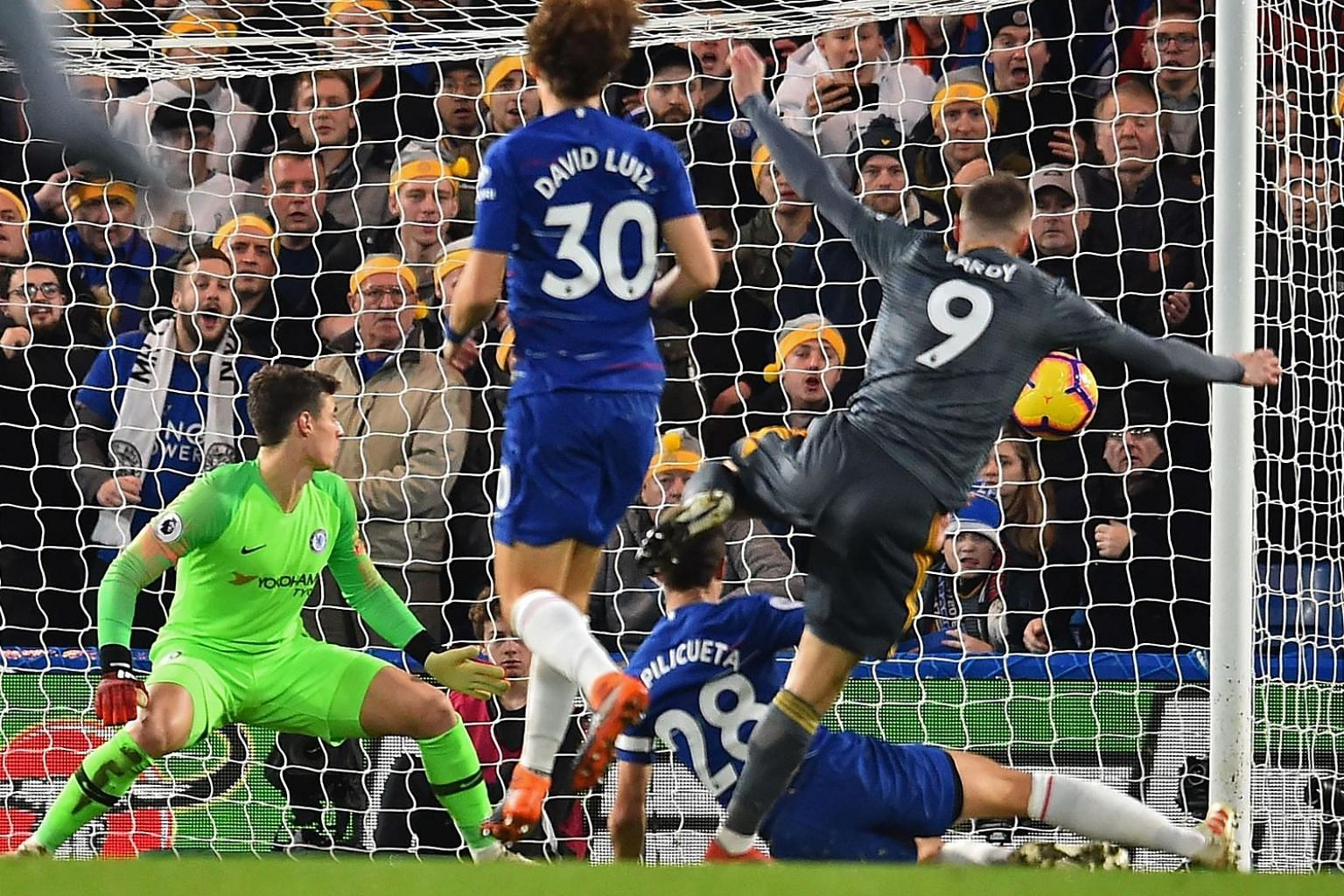 Leicester City's Jamie Vardy scoring the only goal in their English Premier League match against Chelsea on Saturday, the Blues' first home loss of the season.