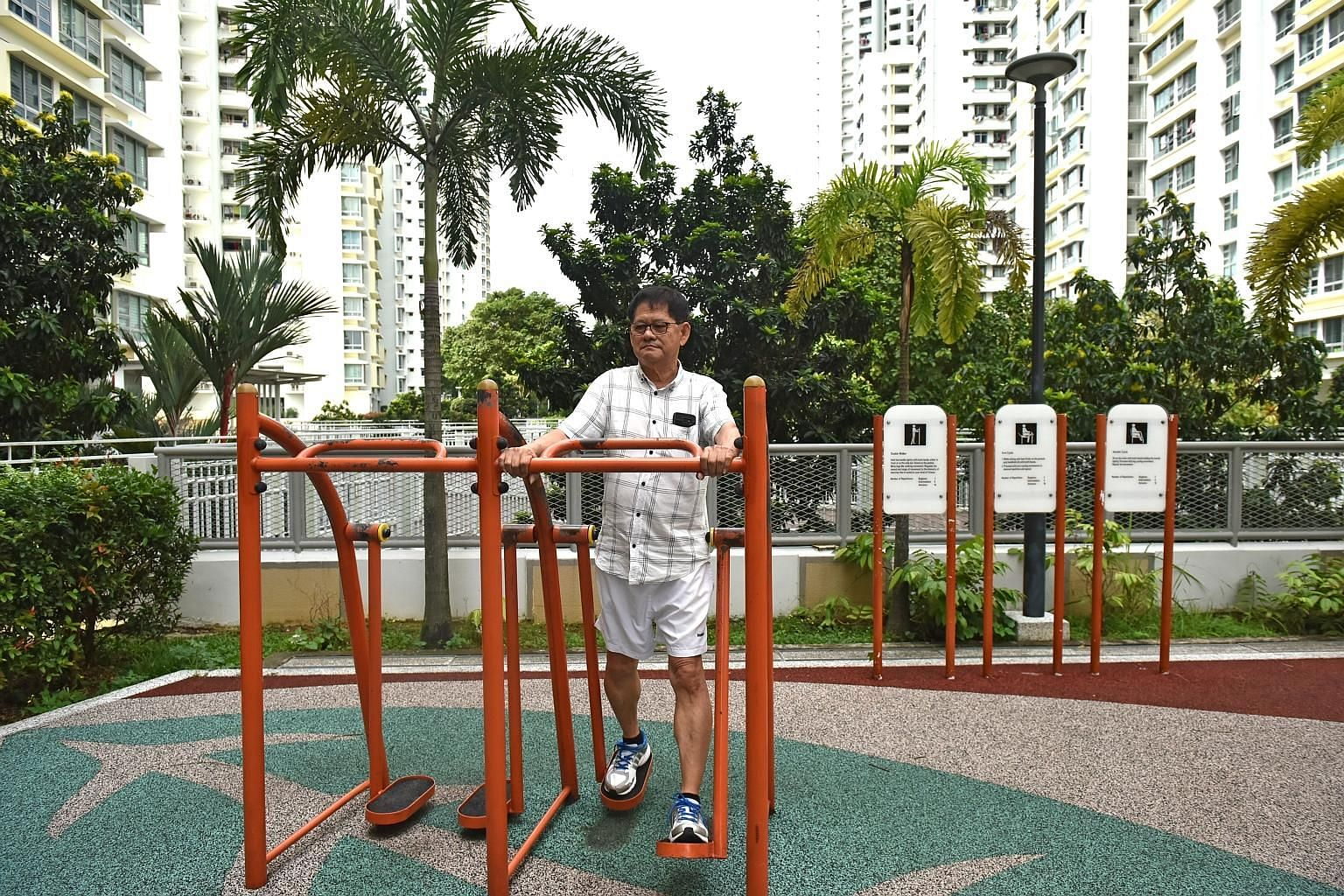 Mr Kuek Chye Heng doing the exercises recommended by the National University Heart Centre, Singapore. Another exercise he gets - keeping up with his three-year-old grandson, whom he sees twice a week.