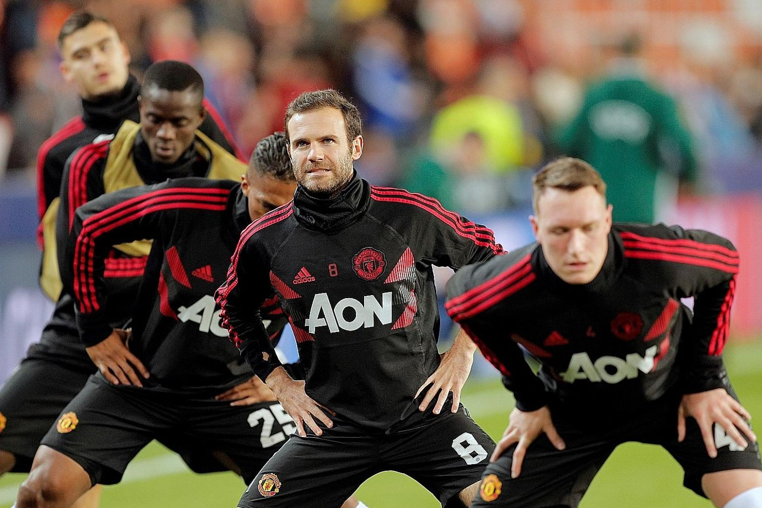 (From right) Phil Jones, Juan Mata and Antonio Valencia warming up before Manchester United's Champions League match against Valencia. Spurred by the arrival of caretaker manager Ole Gunnar Solskjaer, the team have a good chance to close the gap on t