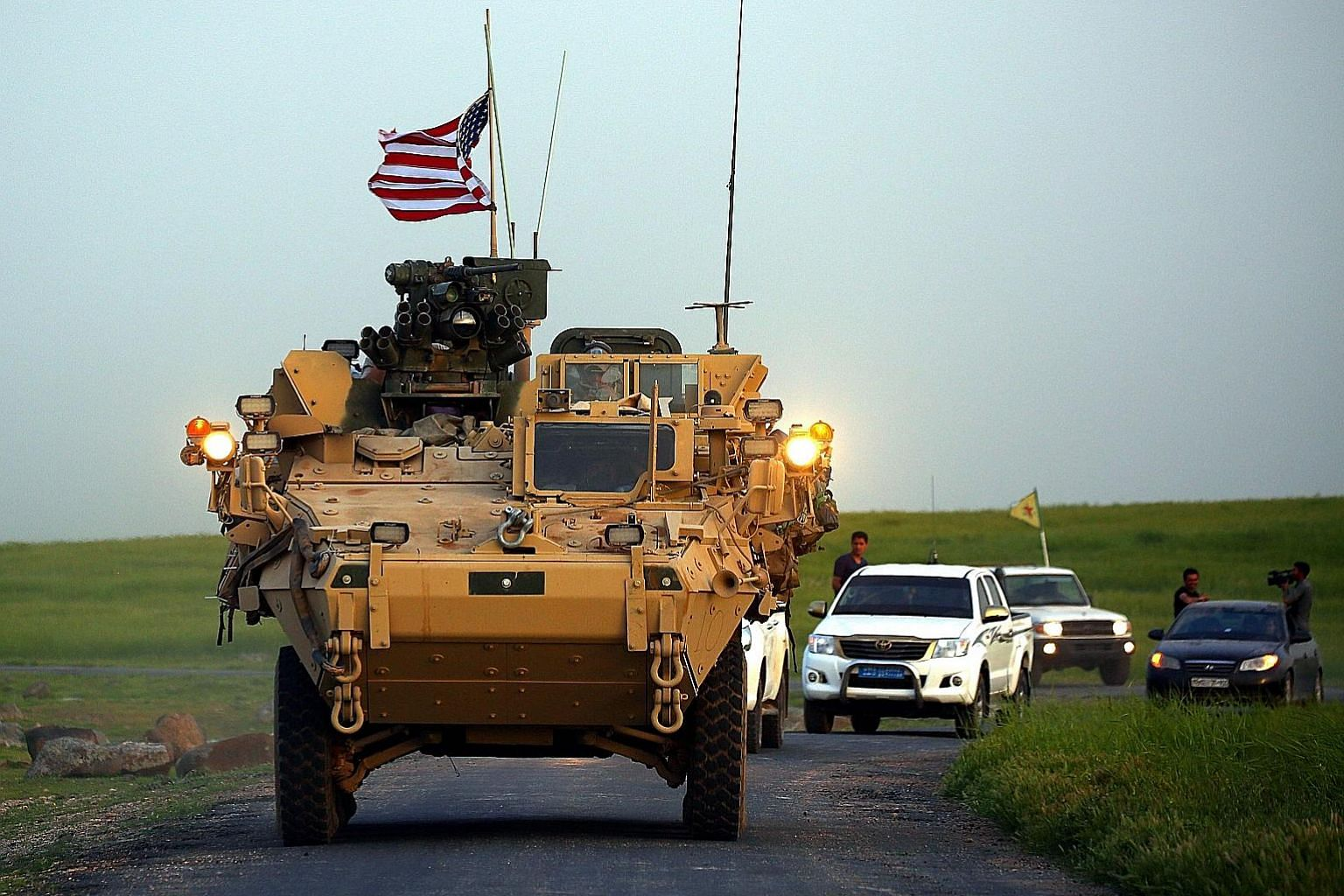 US forces, accompanied by Kurdish fighters of the People's Protection Units, near the Syrian village of Darbasiyah on the border with Turkey. The writer says the pullout of US troops from Syria will leave the Kurds at the mercy of Turkey, which sees