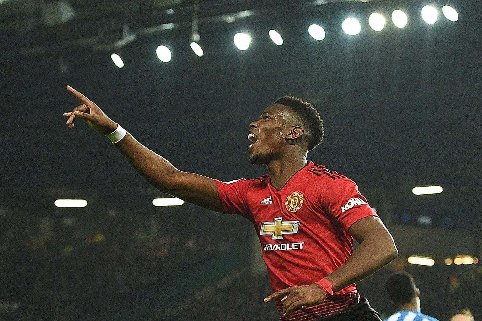 Manchester United's Paul Pogba celebrates after scoring their second goal against Huddersfield. It was the Frenchman's first goal at Old Trafford since October.