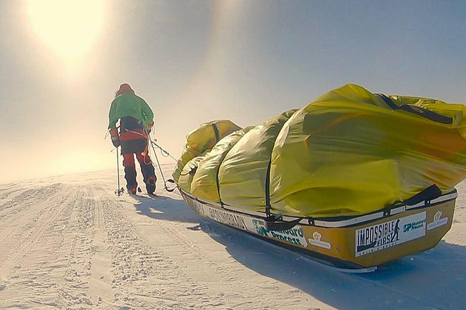 US adventurer Colin O'Brady (above) arrived at the finishing point on the Ross Ice Shelf on the Pacific Ocean on Wednesday after covering a total of 1,480km. The 33-year-old had set off on cross-country skis on Nov 3, hauling supplies on a sled (righ