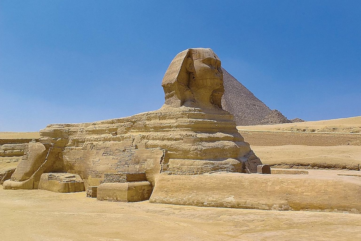 The Great Sphinx of Giza stands on the Giza Plateau on the west bank of the Nile river.