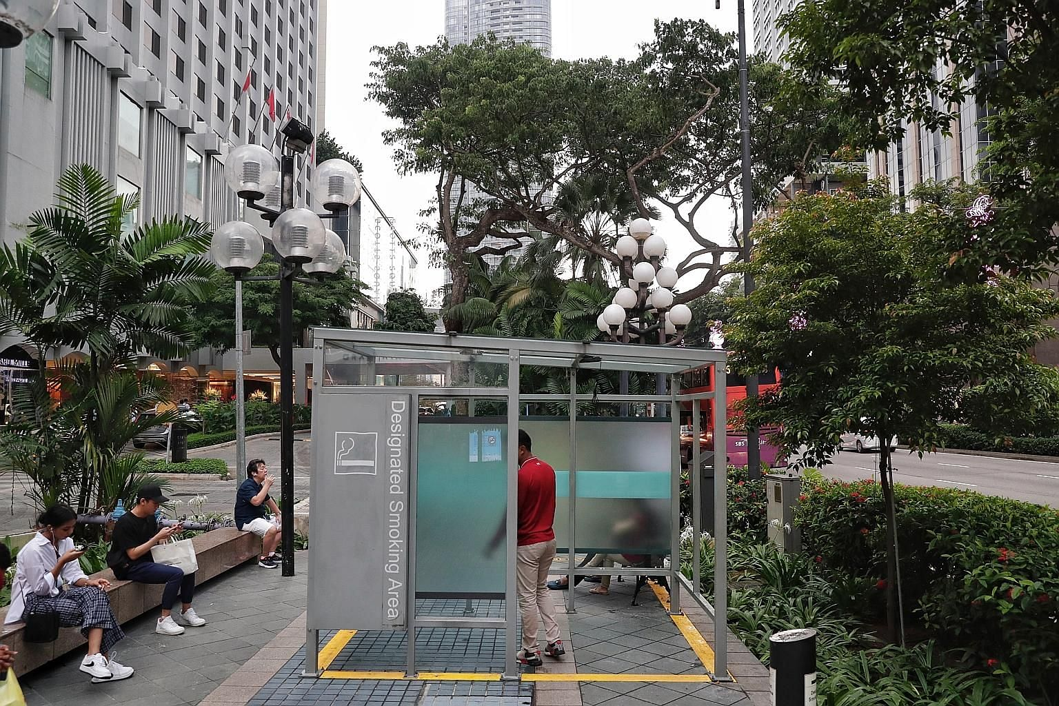 A designated smoking area outside Far East Plaza. The locations of the more than 40 designated smoking areas in the zone can be found on NEA's website as well as brochures at malls and tobacco product retailers.