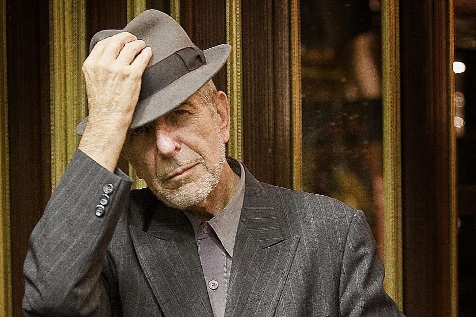 Leonard Cohen's (left) The Flame (above) is an ode to the power of words to seduce, probe and get under one's skin.