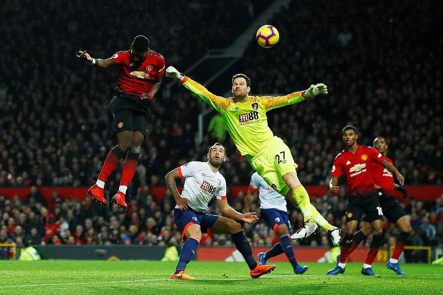 Paul Pogba scoring United's second goal past Bournemouth's Bosnian goalkeeper Asmir Begovic in their 4-1 win at Old Trafford on Sunday. He now has four goals in caretaker manager Ole Gunnar Solskjaer's first three games.