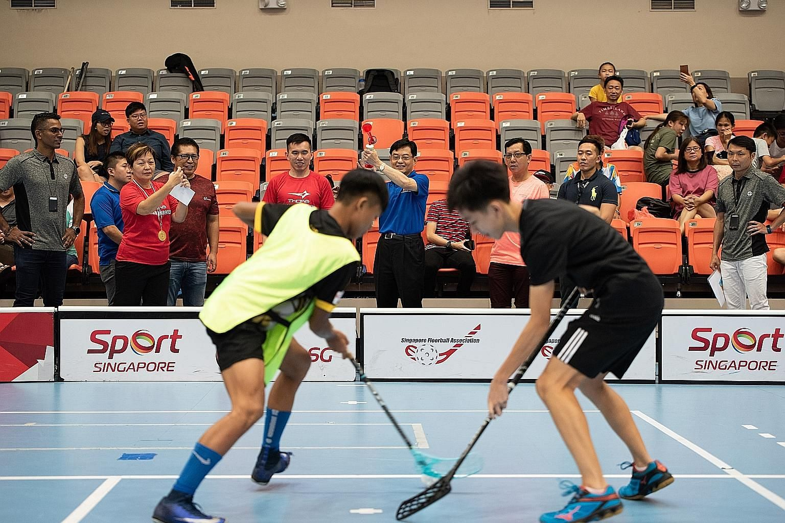 Finance Minister Heng Swee Keat, who is also the adviser to Tampines grassroots organisations, sounding the horn at Our Tampines Hub on Monday for one of the matches at Showdown 2018, a one-day event organised by the Singapore Floorball Association w