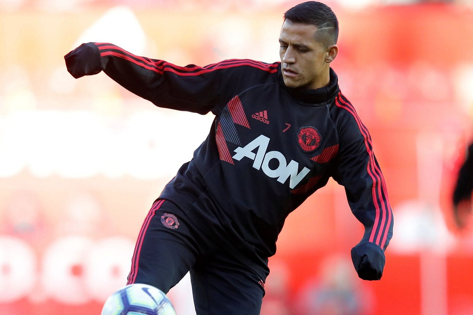 Alexis Sanchez warming up before the league match against Newcastle in October. He was out injured for the whole of last month.