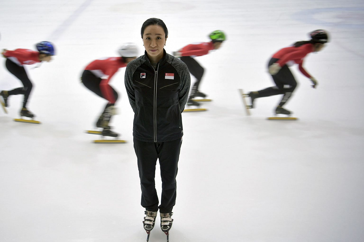 Former national short-track speed skating coach Chun Lee-kyung with her charges in The Rink at JCube in March 2017. She did not renew her contract after a three-year stint as she could not come to an agreement with the association on various matters.