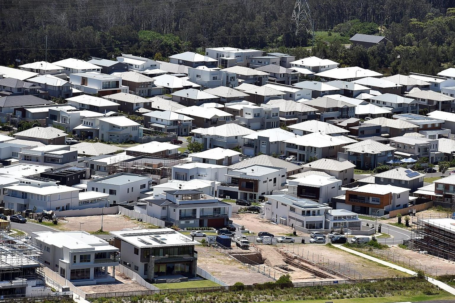 A housing estate near Green Hills Beach at Cronulla in Sydney. In Sydney, home prices stumbled nearly 9 per cent on the year, while Melbourne saw an annual drop of 7 per cent. Sydney and Melbourne comprise about 60 per cent of Australia's housing mar