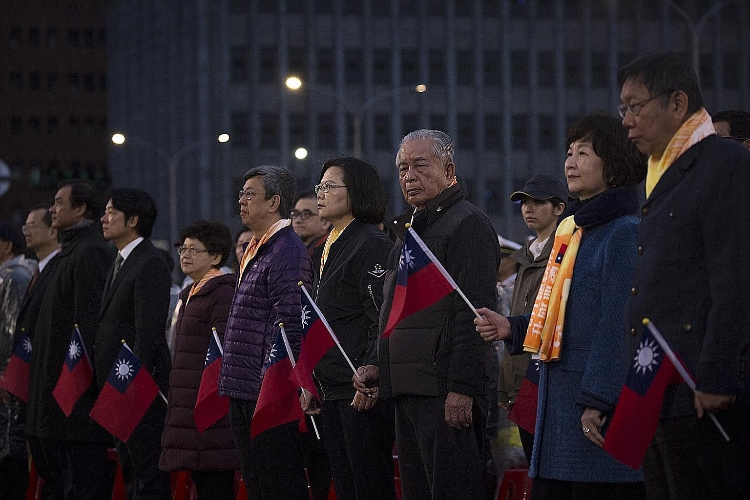 Taiwanese President Tsai Ing-wen (centre) taking part in the national flag-raising ceremony in Taipei on New Year's Day. After her party's serious setback in local elections last November, she has leaned more towards the pro-independence camp in her