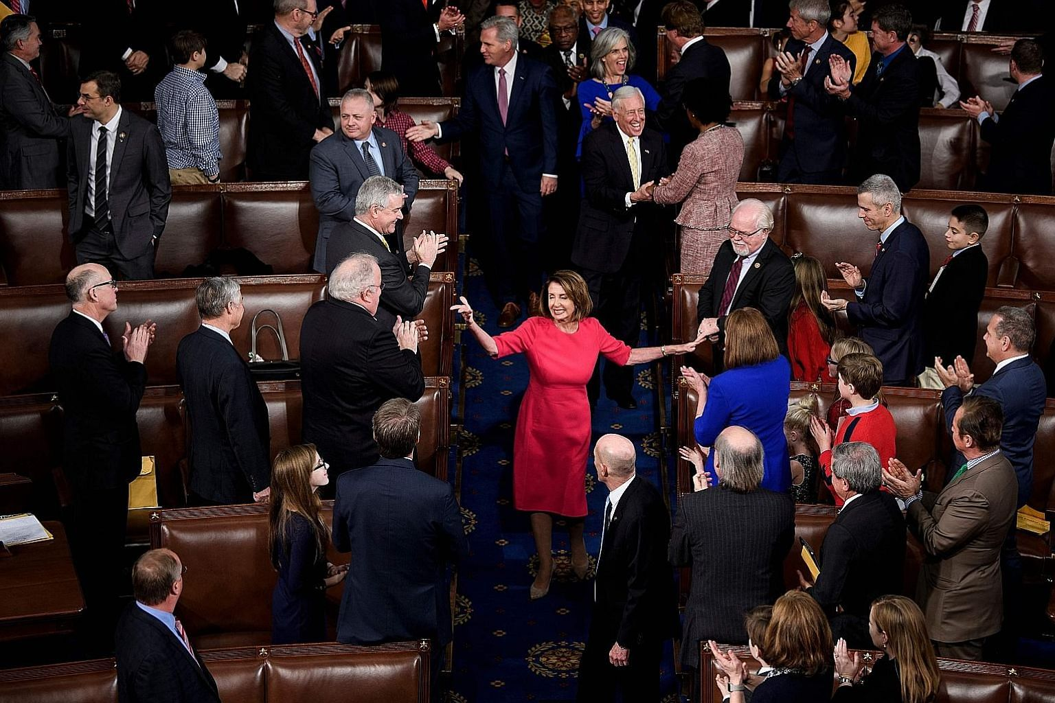 Ms Nancy Pelosi being applauded on Thursday after her election as Speaker of the House in the House of Representatives during the opening session of the 116th Congress.
