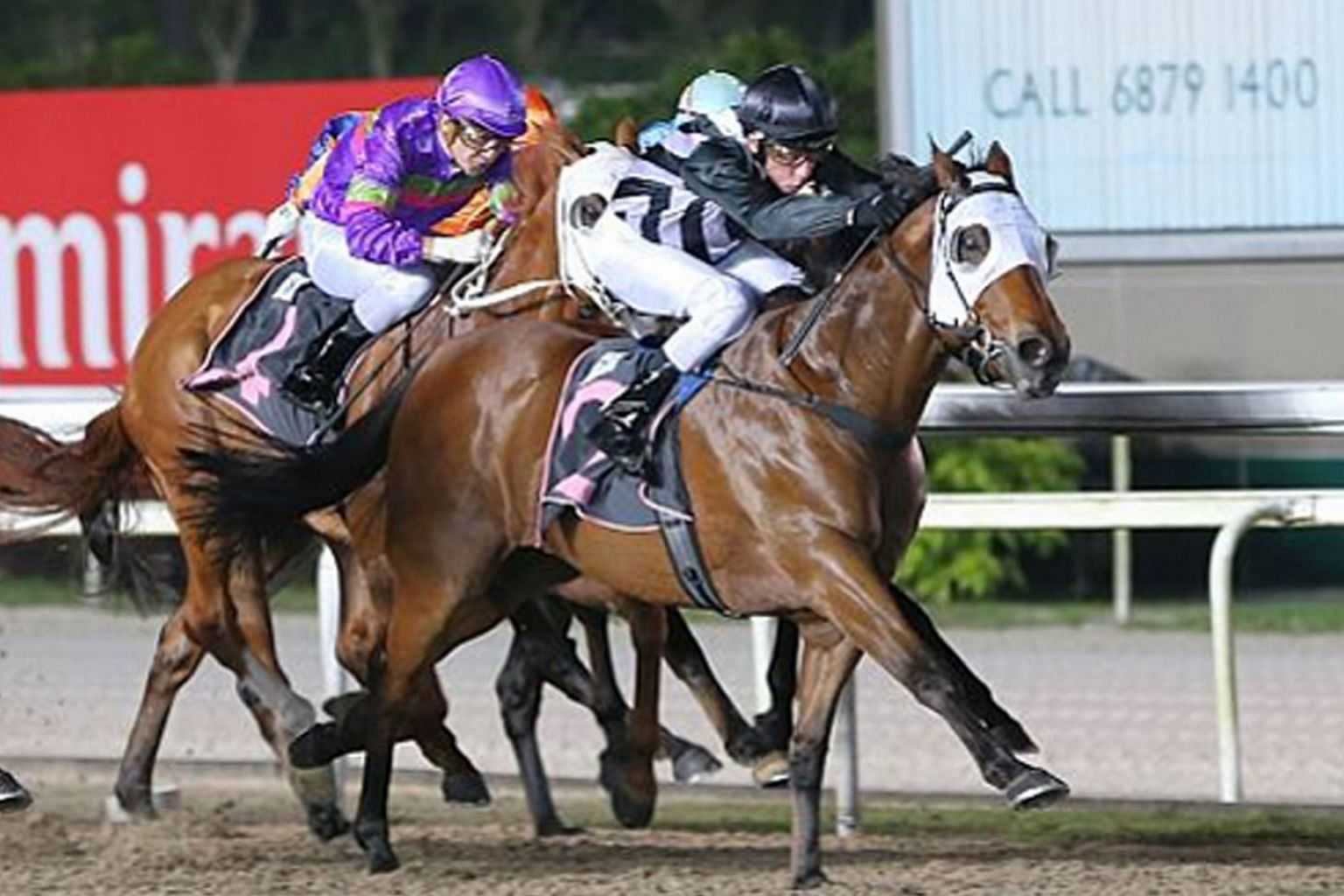 Flak Jacket (black cap) is probably the best of trainer Shane Baertschiger's three runners in tomorrow's $85,000 Kranji Stakes B race over 1,100m.