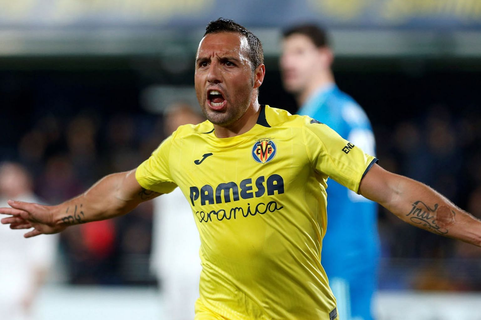 Villarreal midfielder Santi Cazorla celebrating scoring his second against Real Madrid on Thursday. The former Arsenal player's two goals salvaged a draw for struggling Villarreal.