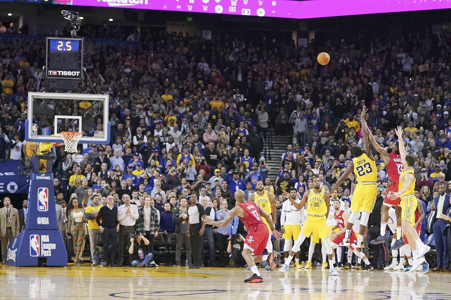 Houston Rockets guard James Harden (13) shooting the game-winning three-pointer, despite being double-teamed by the Golden State Warriors during overtime at the Oracle Arena on Thursday. The Rockets rallied from a 20-point second-half deficit to win