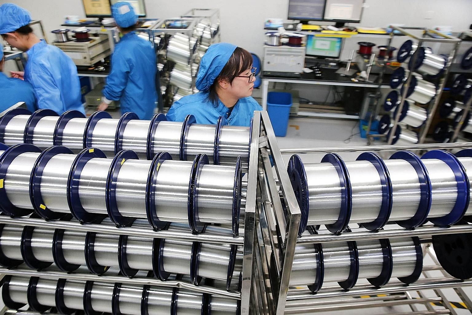A fibre-optic cable factory in China's Jiangsu province. Head honchos in Singapore rank South-east Asia ahead of China for growth and investment opportunities, with US-China trade tensions their main concern.