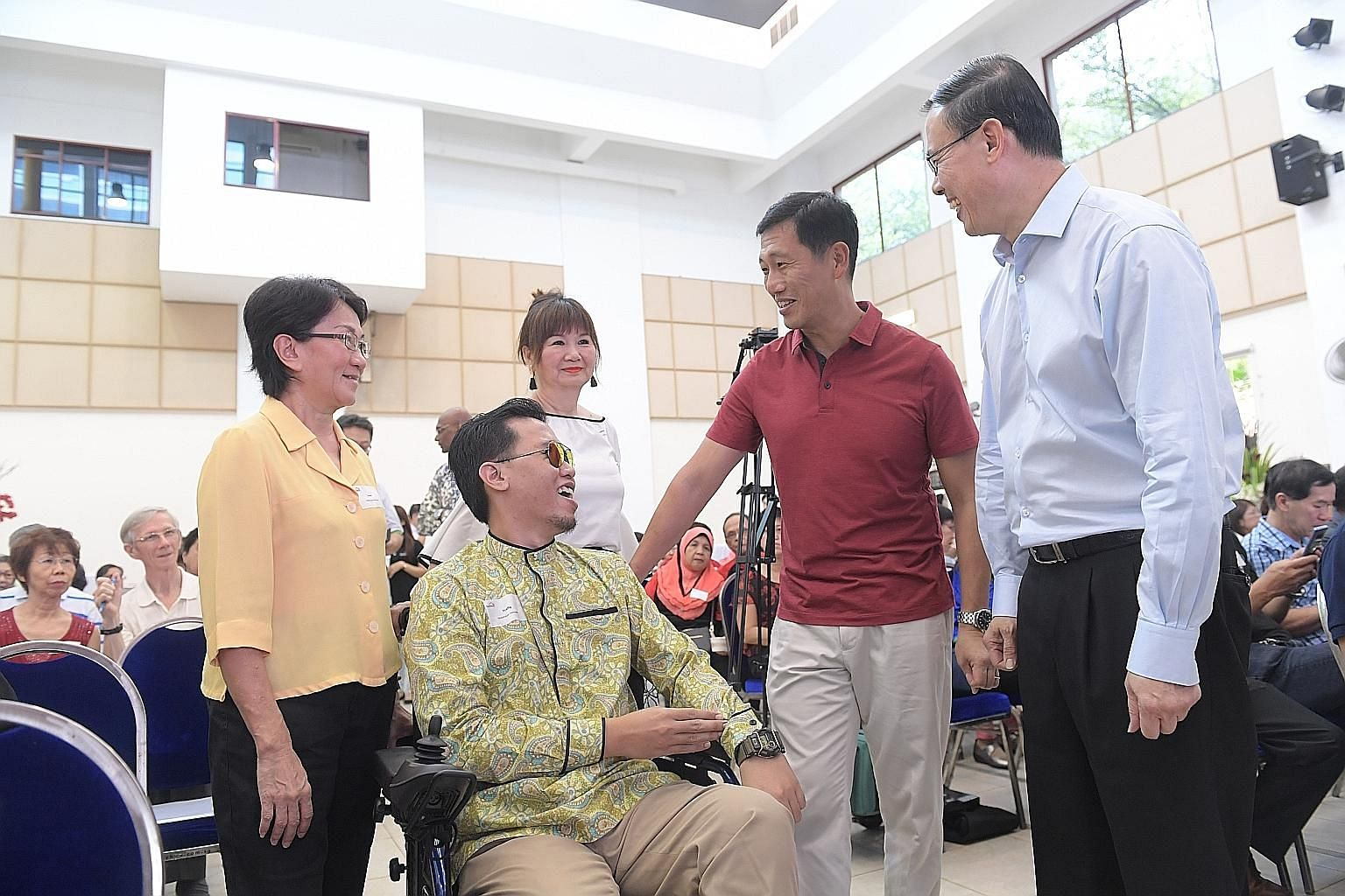 Education Minister Ong Ye Kung and Mayor of North West District, Dr Teo Ho Pin, with Mr Muhammad Syafiq Mohammad Ali, Ms Jessie Tay (left), 61, and Ms Pauline Chan, 62, at yesterday's event.