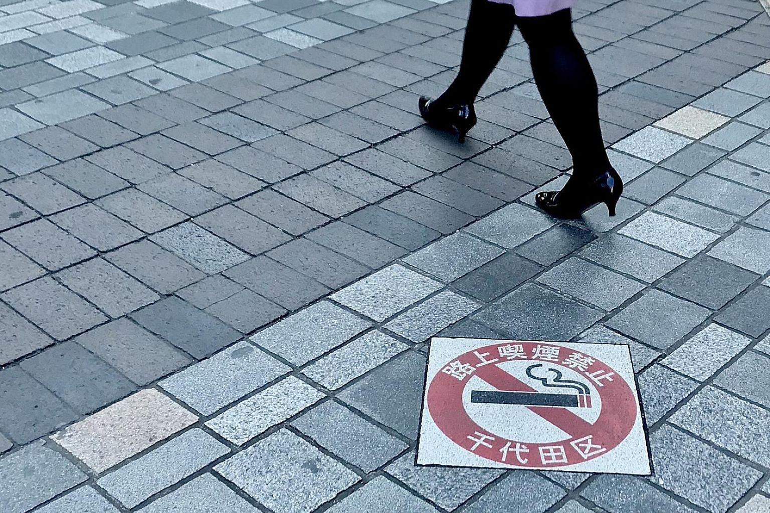 """A """"No Smoking On The Streets"""" sign in Tokyo's Chiyoda ward, the first of the Japanese capital's 23 wards to outlaw public smoking in 2002, with offenders facing fines of 2,000 yen (S$25)."""