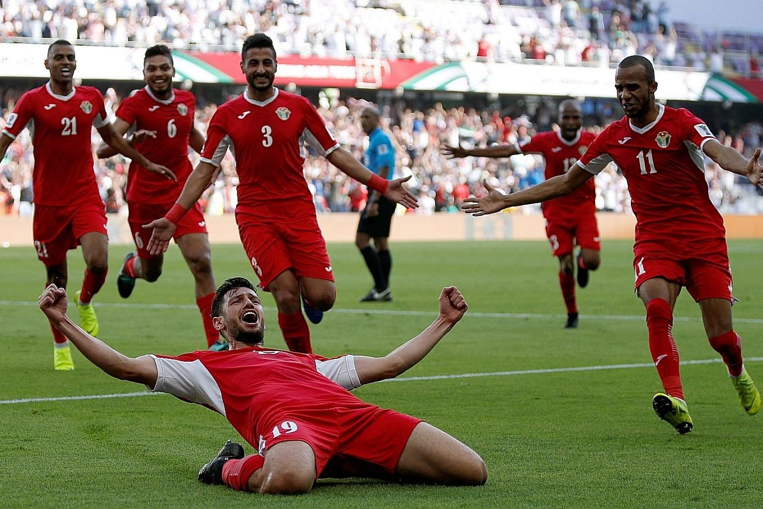 Anas Bani Yaseen expressing his delight after scoring what proved to be the winner in Jordan's 1-0 upset win over defending Asian Cup champions Australia in their Group B opener yesterday.