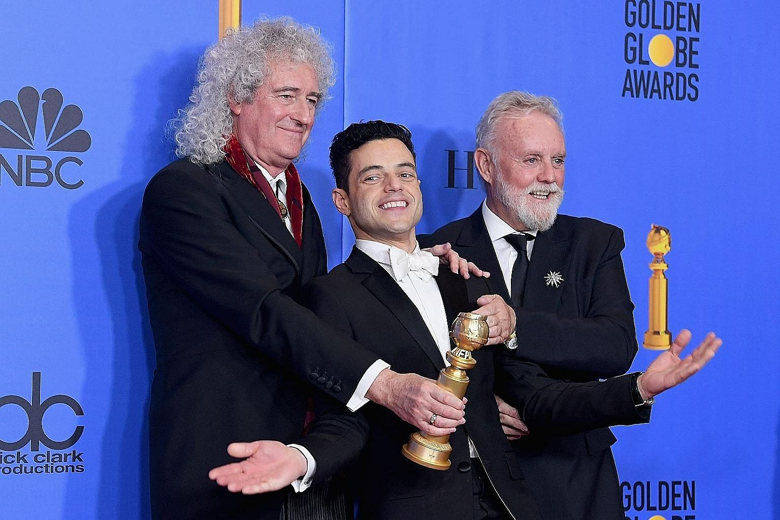 Actor Rami Malek (centre), flanked by Queen's Brian May and Roger Taylor, was crowned best actor in a movie (drama) for his role as the band's frontman Freddie Mercury in Bohemian Rhapsody.