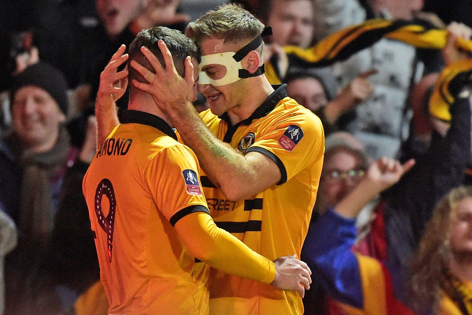 Above: Newport County's unlikely 2-1 triumph over the 2016 Premier League champions Leicester City in the third round of the FA Cup on Sunday exemplified the romance of the competition, leaving fans like this man struggling to contain his delight and