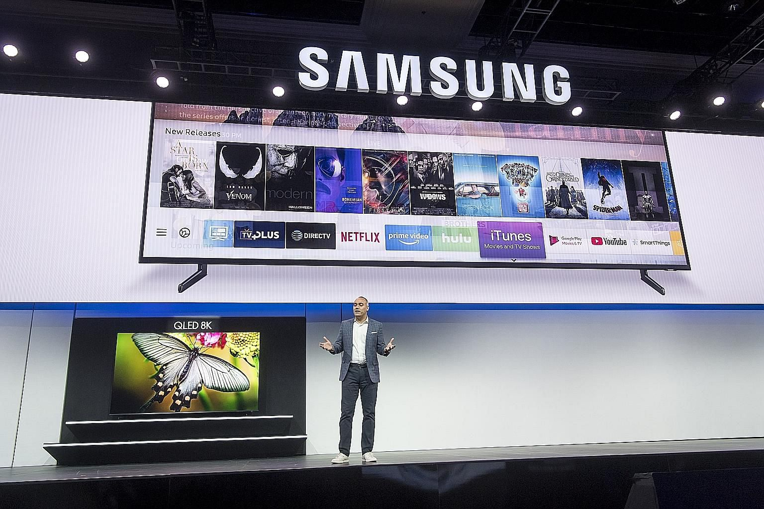 Mr Dave Das, senior vice-president of consumer electronics at Samsung Electronics America, giving a presentation of his company's new range of TV units, which will have a dedicated iTunes app. With the trend towards bigger TVs, Samsung and LG have un