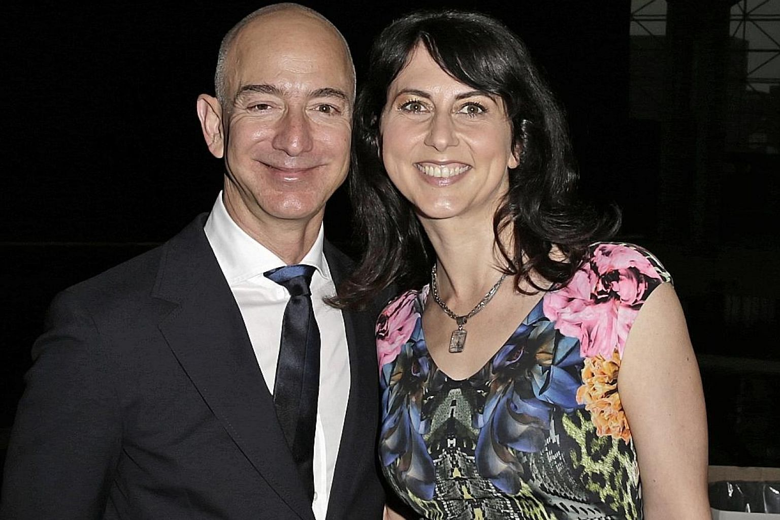 Mr Jeff Bezos and his wife MacKenzie. They met when he interviewed her for a job at New York hedge fund D. E. Shaw & Co in 1993.